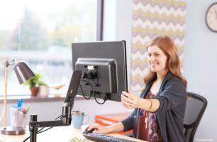 This AmazonBasics Wall Mount Monitor Stand Saves Space and is Ergonomic Too!